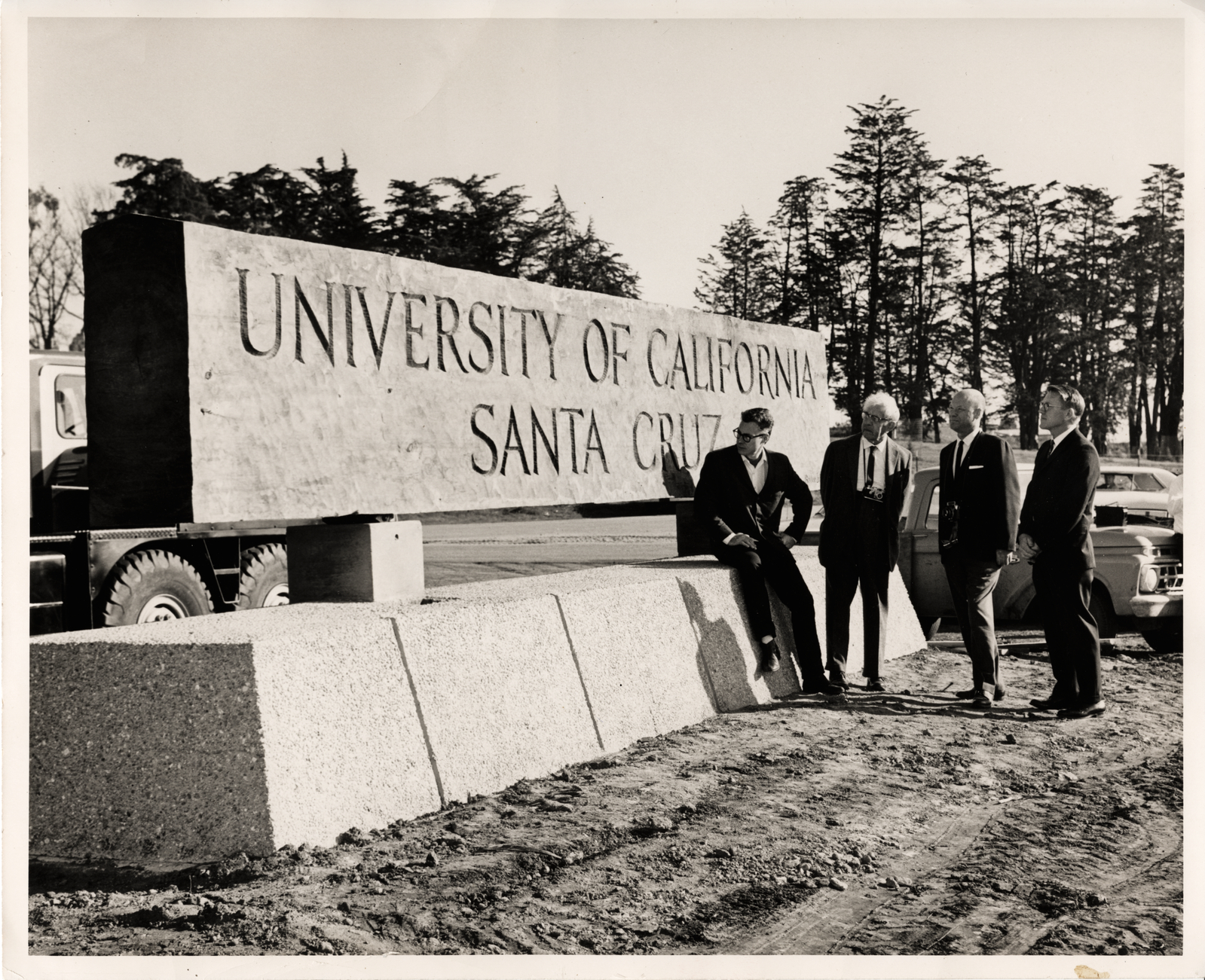 Founders looking at UCSC sign in 1965